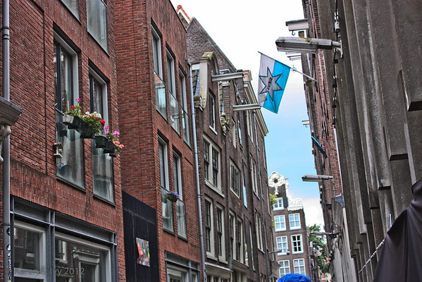 Amsterdam houses lean into the street