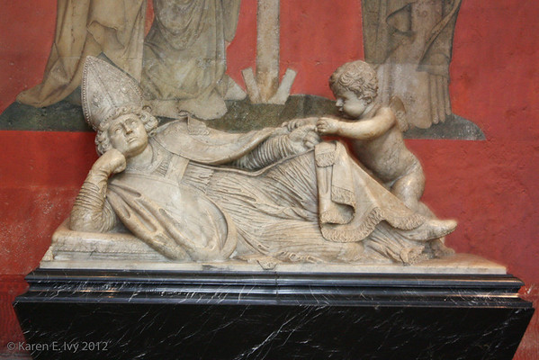 Statue of reclining bishop
